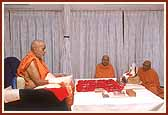 As a consequence of physical exertion during his visit of 11 villages on 4 Feb, Swamishri was struck with fever and illness. The next morning he performs his puja in his room
