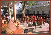 The tribal devotees then present a traditional dance before Swamishri