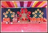 A colorful backdrop of flowers symbolises the onset of Vasant (Spring season) in India. Swamishri during the Vasant Panchami Celebration