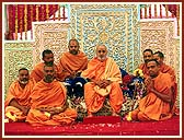 Swamishri with sadhus involved in tribal upliftment activities