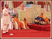 MP, Shri L.M.Singhvi, praised Swamishri's services to mankind, and recited a poem dedicated to him