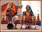 Children play traditional instruments