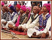 Adivasis (tribals) in traditional garb, with their hand-made bows and arrows