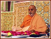 Performing tilak chandlo and chanting the name of Swaminarayan during his morning puja