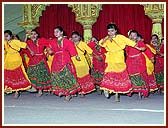 The balika mandal - girls group - enthusiastically performed a folk dance