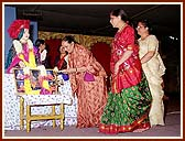 The Women's Convention began with the arti of the murti of Lord Swaminarayan and the Guru Parampara