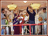 Devotees performing Maha-Abhishek by pouring holy water brought from 108 rivers