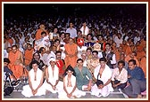 Swamishri with youth performers of the grand drama ' Karna's Enigma'