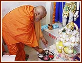 Performing Vedic worship (pujan) of Shivling, Shri Shiv-Parvati and Ganpatiji