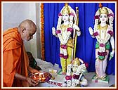 Performing Vedic worship (pujan) of Shri Sita-Ram and Hanumanji
