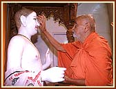 Performing the pujan of Shri Ghanshyam Maharaj