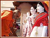 Offering respects at the feet of Shri Harikrishna Maharaj and Shri Radha Krishna Dev