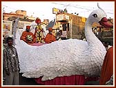 On the streets of Valsad the murtis of Shri Akshar Purushottam Maharaj, Shri Harikrishna Maharaj and Shri Ghanshyam Maharaj are paraded in a Peacock float, Swan float and Fish float respectively