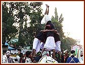 Exciting human pyramids during the procession by youth dancers, sadhus and tribal youths