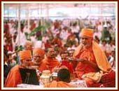 Performing arti of Lord Harikrishna Maharaj at the culmination of the Yagna ceremony