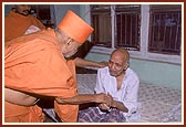 Blessing an ailing old devotee