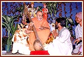 After a tribal dance, Swamishri inquires about the musical instrument played by a tribal devotee