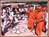 Tribal youth welcoming Swamishri with traditional music and dance