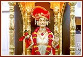 During the nine-day Shri Hari Jayanti Festival (L to R) the murtis of Ghanshyam Maharaj, Bal Ghanshyam and Ghanshyam Maharaj (in wood) were beautifully decorated each day in the mandir sanctum