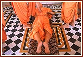 Swamishri prostrating at the Smruti Mandir, where Lord Swaminarayan was cremated, Laxmi Vadi