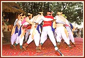 Colorfully dressed tribal youths enthusiastically perform the local Dangi dance