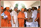 The modern, well equipped Pramukh Swami Hospital	Opening of Hospital by Swamishri and Chief Minister Shri Keshubhai Patel (right) with Health Minister Shri Ashok Bhatt (left)