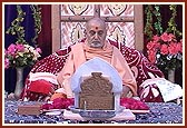 Swamishri meditating and saying the rosary during his morning puja