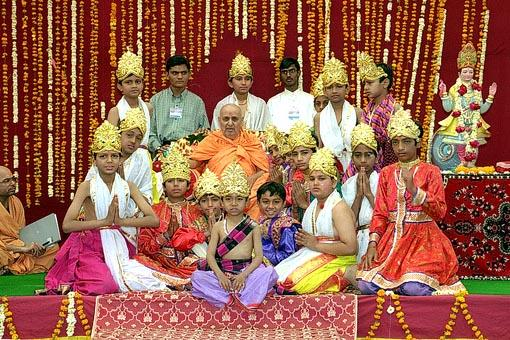 Children with Swamishri after performing a dance