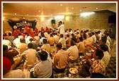 Devotees performs arti in maha-puja