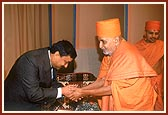 Indian Ambassador, H.E. Prabhu Dayal, greets Swamishri
