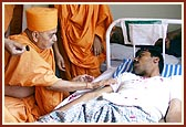 Swamishri listens to each of the victims' account and soothes them with comforting words, touch and prayers
