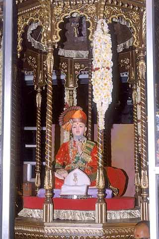 The decorated murti of Lord Swaminarayan in a twelve-faced hindolo