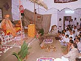 Addressing the devotees