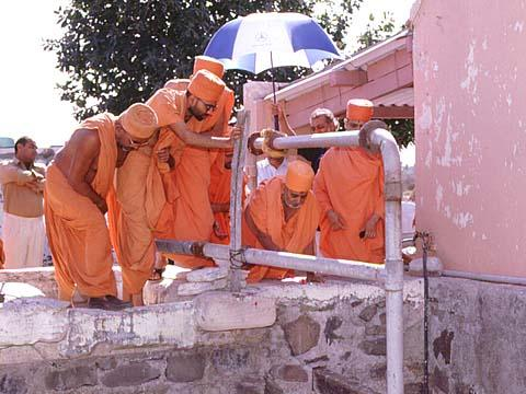 Sanctifying a well by showering flowers, Jamnagar