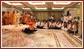 Swamishri engaged in darshan of Shri Nilkanth Varni (abhishek murti)