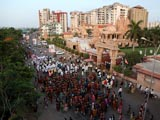 Devotees arrive at mandir on foot after performing padyatra