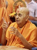 Swamishri in a divine mood blessing the devotees