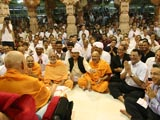Swamishri in a divine jovial mood while interacting with devotees