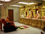 Swamishri engaged in darshan of Shri Guru Parampara