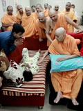 Swamishri blesses an ailing boy