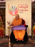 Swamishri lights a lamp to inaugurate the Diamond Jubilee Celebrations of BAPS' Youth Activities