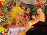 Swamishri engaged in darshan of utsav murti of Brahmaswarup Yogiji Maharaj