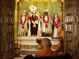 Swamishri engaged  in darshan of Shri Varninath Dev and Shri Gopinath Dev