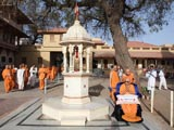 Swamishri engaged in darshan of holy shrine