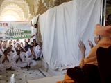 Swamishri blesses youths in the mandir pradakshina