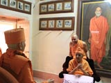 Swamishri engaged in darshan of Shri Yogiji Maharaj