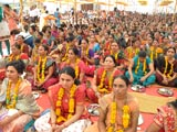 Mothers of sadhaks participate in  mahapuja at the diksha ceremony