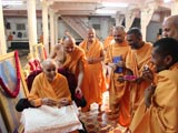 Swamishri in a jovial mood while performing the pujan for murti-pratishtha