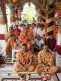 Sadhus and devotees engaged in patotsav mahapuja rituals