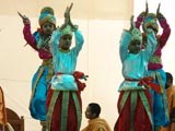 Kids perform a dance before Swamishri